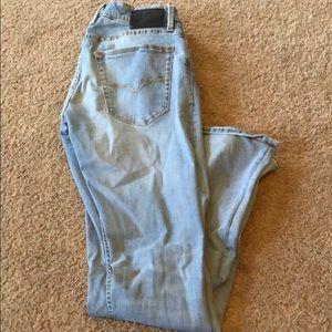 Men's distressed light wash jeans